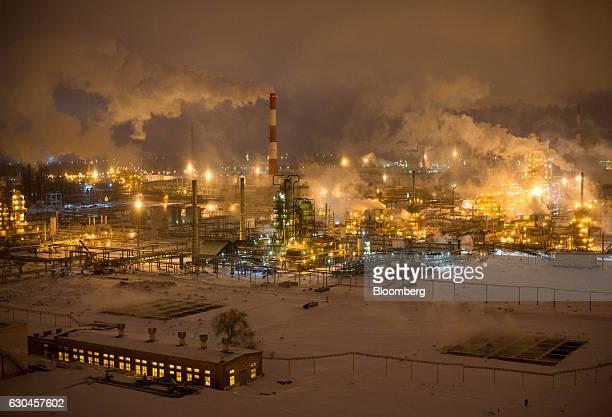 Lights illuminate the Novokuibyshevsk oil refinery plant operated by Rosneft PJSC in Novokuibyshevsk Samara region Russia on Wednesday Dec 21 2016...