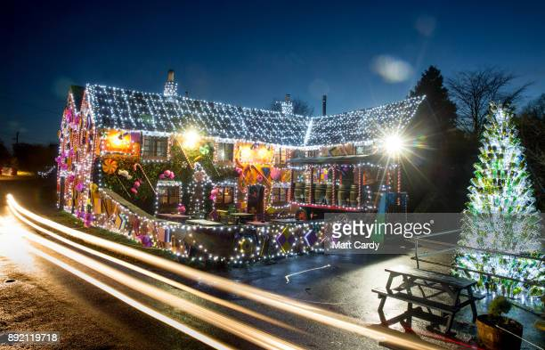 Lights illuminate the Queen Victoria Inn in the village of Priddy that has been transformed into a giant gingerbread house in time for Christmas near...