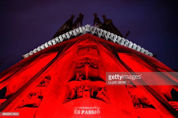 Lights illuminate the the 12 sculptures depicting Jesus Christ on the day of his crucifixion by Josep Maria Subirachs, on the Passion facade of the...