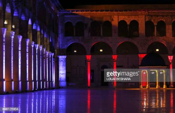 Lights illuminate the Umayyad Mosque in the Old City of the Syrian capital Damascus on June 14 2017 during for the Muslim holy month of Ramadan / AFP...