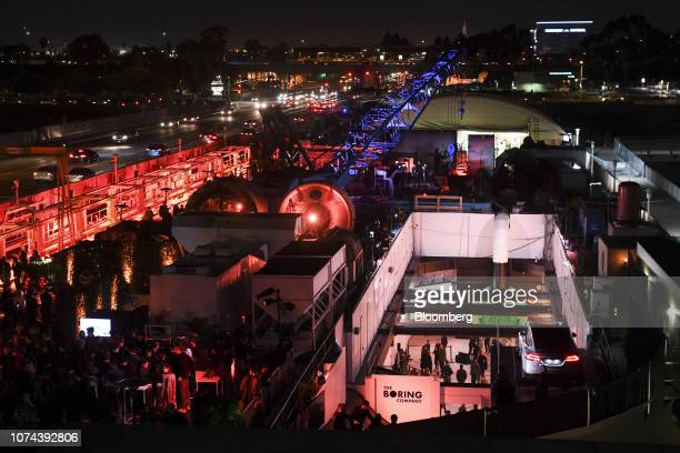 Lights illuminate tunnel boring equipment and the tunnel pit entrance during an unveiling event for the Boring Co. Hawthorne test tunnel in...