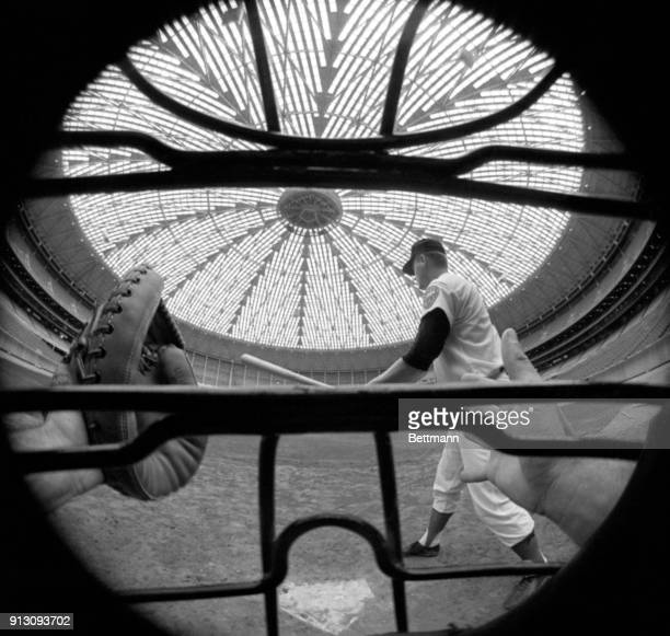Lights in the dome of Houston's new indoor stadium shine high above the diamond as Astro infielder Rusty Staub gets ready to swing the bat in the...