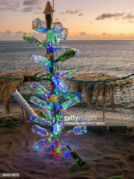 lights of a caribbean bottle christmas tree - caribbean christmas stock pictures, royalty-free photos & images