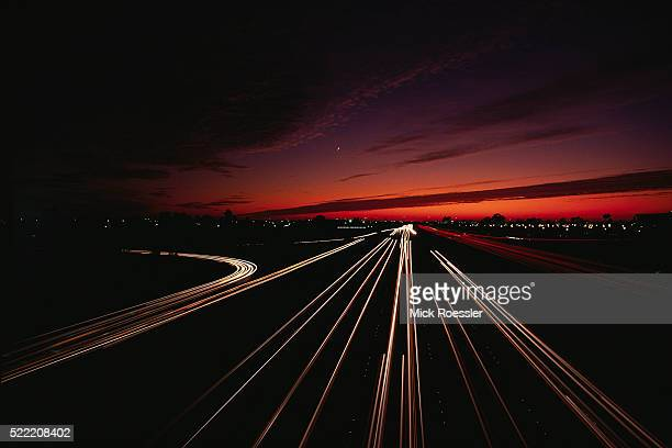 lights of freeway at dusk - costa mesa stock photos and pictures