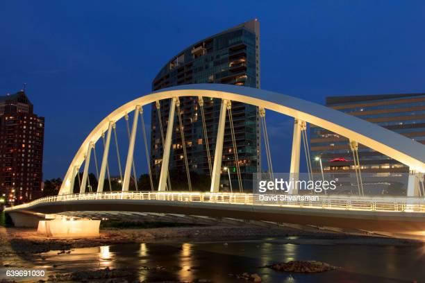 lights of main street bridge over scioto river in downtown columbus ohio - columbus ohio stock pictures, royalty-free photos & images