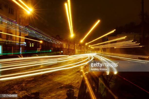 lights of the night city - russia stock pictures, royalty-free photos & images