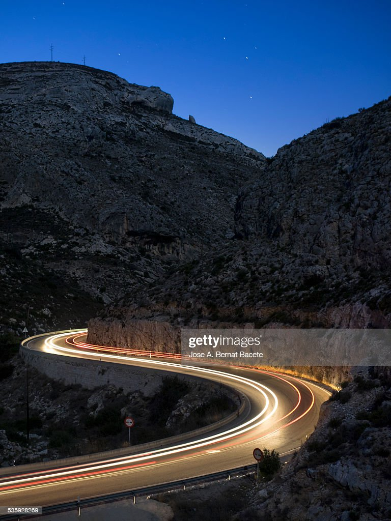 Lights of vehicles in a road in the night : Stock Photo