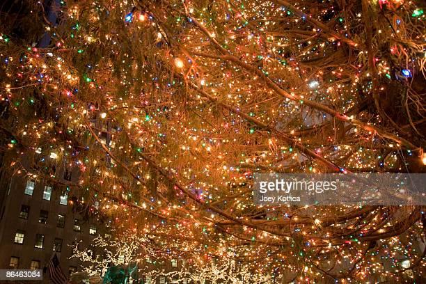 lights on christmas tree, rockefeller center, new york city - rockefeller center foto e immagini stock