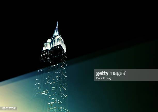 lights on empire state building - empire state building stock pictures, royalty-free photos & images