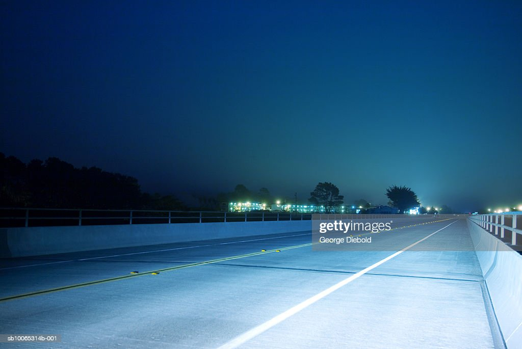 Lights on empty highway at night : Foto stock