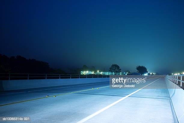 Lights on empty highway at night