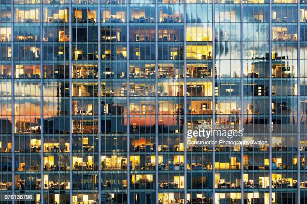 Lights on in office block Britannia Tower City of London