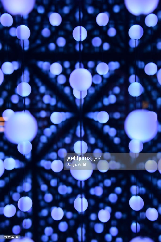 Lights reflected in infinity mirrors : Stock Photo