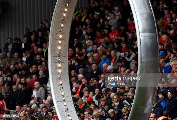 Lights representing each victim are illuminated during a memorial service at Anfield in Liverpool north west Engand on April 15 on the 26th...