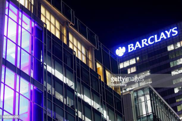 Lights shine from Barclays Plc head offices at the Canary Wharf business financial and shopping district in London UK on Tuesday March 21 2017...