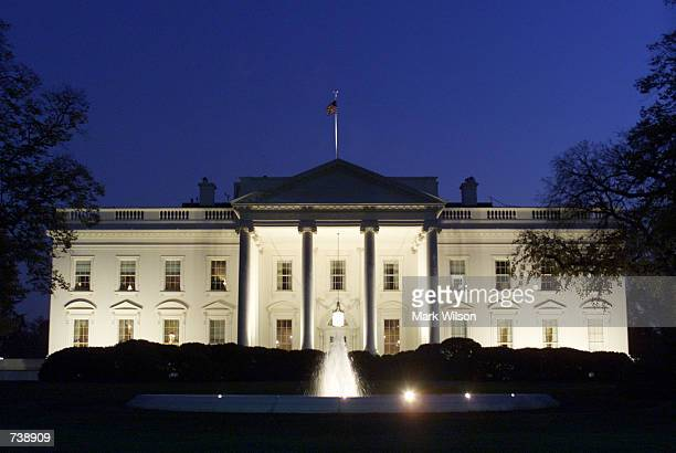 Lights shine on the White House early in the evening November 20 2001 in Washington DC US President George W Bush announced that the White House a...