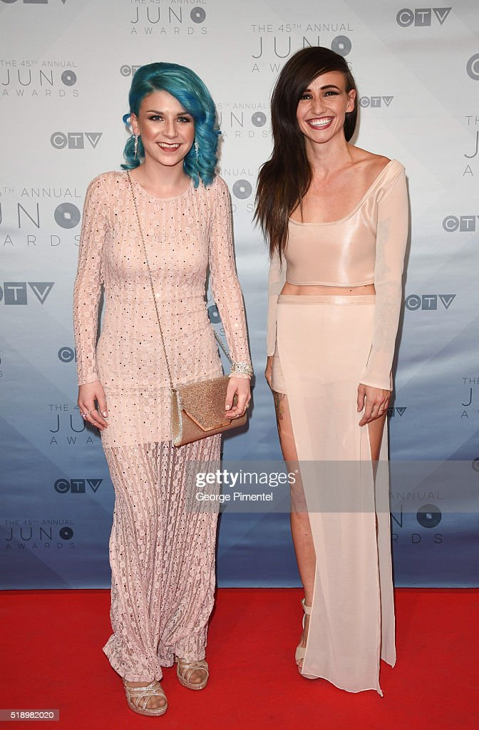Lights singer/songwriter Valerie Anne Poxleitner Bokan (R) and Sam Spensley arrive at the 2016 Juno Awards at Scotiabank Saddledome on April 3, 2016 in Calgary, Canada.
