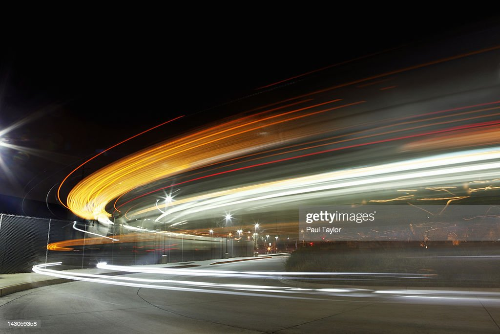 Lights Streaking in Arc at Night : Stock Photo