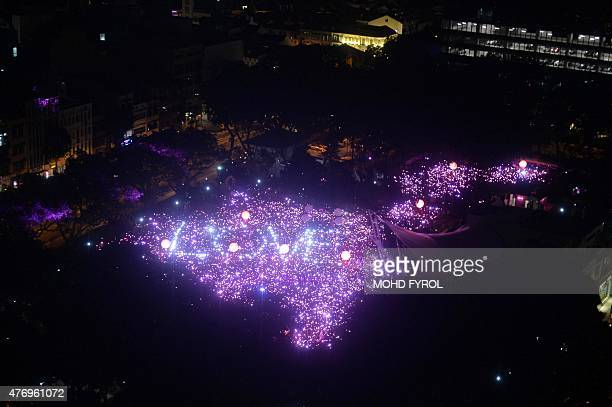 Lights that read love are seen as thousands gather for at the annual Pink Dot event in a public show of support for the LGBT community at Hong Lim...