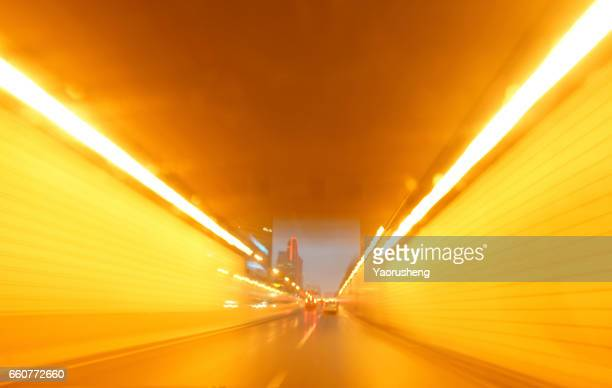 lights tunnel driving - zoom background stock pictures, royalty-free photos & images