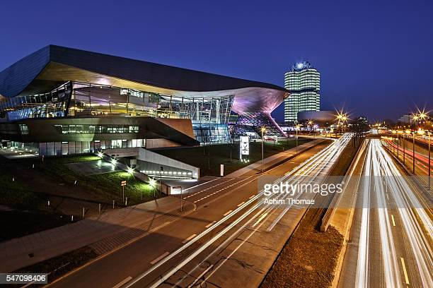 lighttrails and bmw world, munich, germany - munich stock pictures, royalty-free photos & images