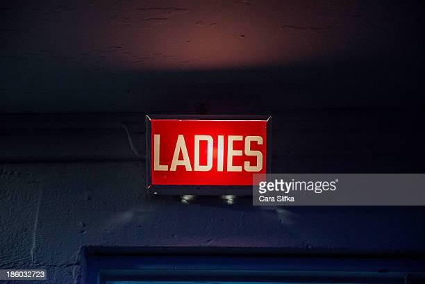 Light-up retro ladies bathroom sign