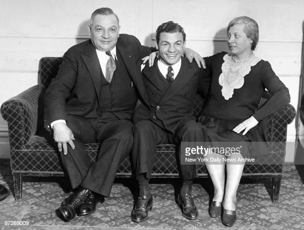 Lightweight boxing champion Tony Canzoneri with his parents George and Josephine Canzoneri at Hotel Endicott
