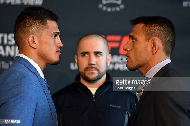 UFC lightweight champion Anthony Pettis and oponent Rafael dos Anjos of Brazil face off during the UFC 185 Ultimate Media Day at the American...