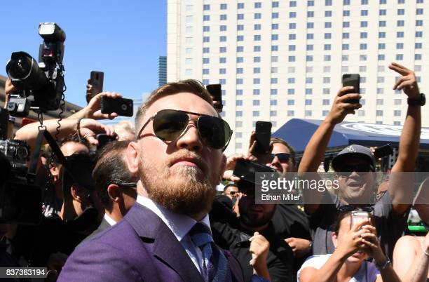 UFC lightweight champion Conor McGregor arrives at Toshiba Plaza on August 22 2017 in Las Vegas Nevada McGregor will fight Floyd Mayweather Jr in a...