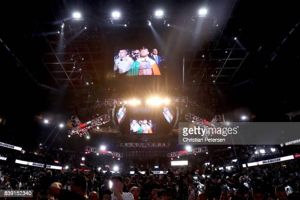 UFC lightweight champion Conor McGregor enters the arena before his official weighin at TMobile Arena on August 25 2017 in Las Vegas Nevada McGregor...