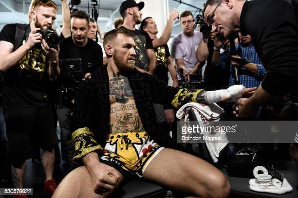 UFC lightweight champion Conor McGregor gets his hands wrapped during a media workout at the UFC Performance Institute on August 11 2017 in Las Vegas...