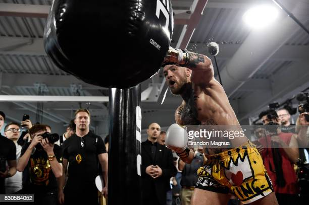 UFC lightweight champion Conor McGregor hits the uppercut bag during a media workout at the UFC Performance Institute on August 11 2017 in Las Vegas...