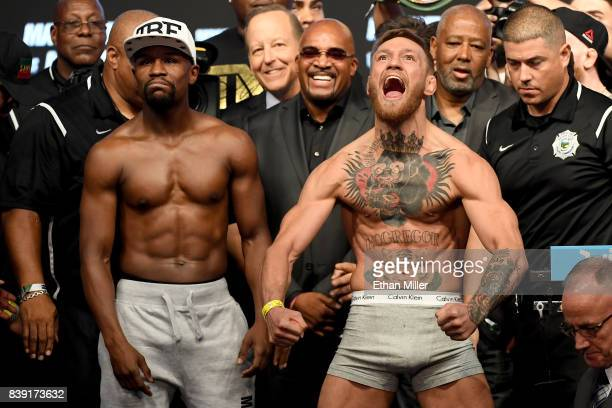 UFC lightweight champion Conor McGregor screams after the face off with Floyd Mayweather Jr during their official weighin at TMobile Arena on August...