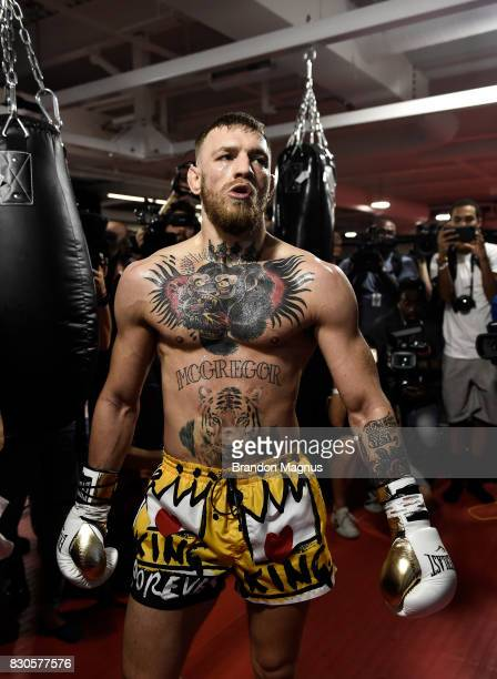 UFC lightweight champion Conor McGregor walks to the next heavy bag during a media workout at the UFC Performance Institute on August 11 2017 in Las...