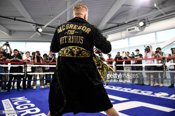 UFC lightweight champion Conor McGregor warms up in the boxing ring during a media workout at the UFC Performance Institute on August 11 2017 in Las...