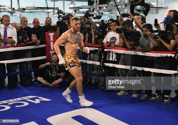 UFC lightweight champion Conor McGregor works on his footwork during a media workout at the UFC Performance Institute on August 11 2017 in Las Vegas...