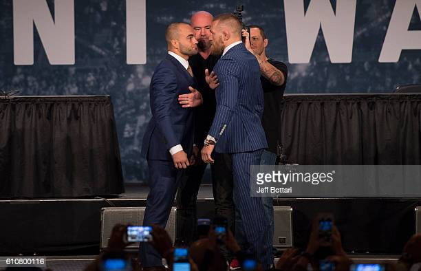 UFC lightweight champion Eddie Alvarez and UFC featherweight champion Conor McGregor face off for the media and fans during the UFC 205 press event...