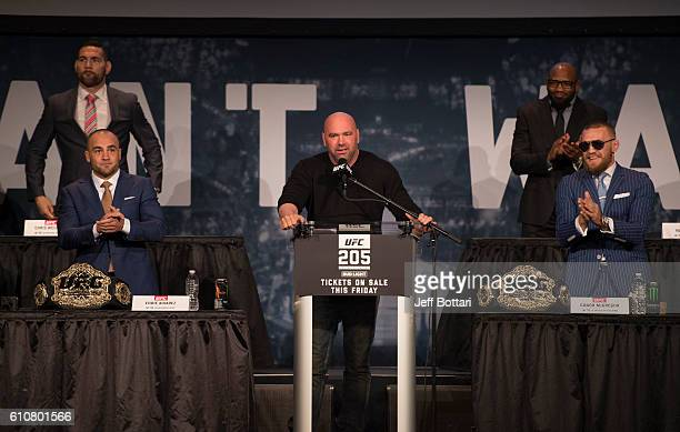 UFC lightweight champion Eddie Alvarez UFC President Dana White and UFC featherweight champion Conor McGregor interact with the media and fans during...