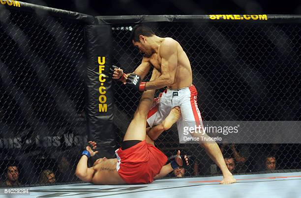Lightweight Champion Efrain Escudero red trunks and Phillipe Nover white trunks fight for the Lightweight Title at the UFC bout that he won against...