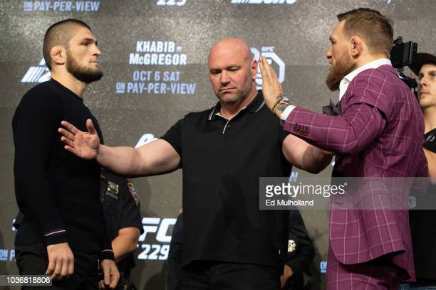 UFC lightweight champion Khabib Nurmagomedov IL and Conor McGregor face off after the UFC 229 press conference at Radio City Music Hall on September...