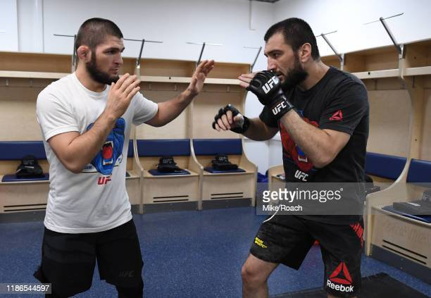 UFC lightweight champion Khabib Nurmagomedov warms up teammate and cousin Abubakar Nurmagomedov of Russia during the UFC Fight Night event at CSKA...