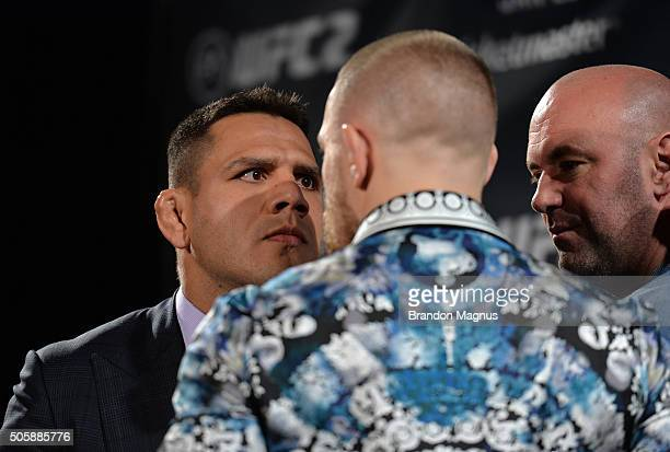 UFC lightweight champion Rafael dos Anjos and UFC featherweight champion Conor McGregor face off during the UFC 197 onsale press conference event...