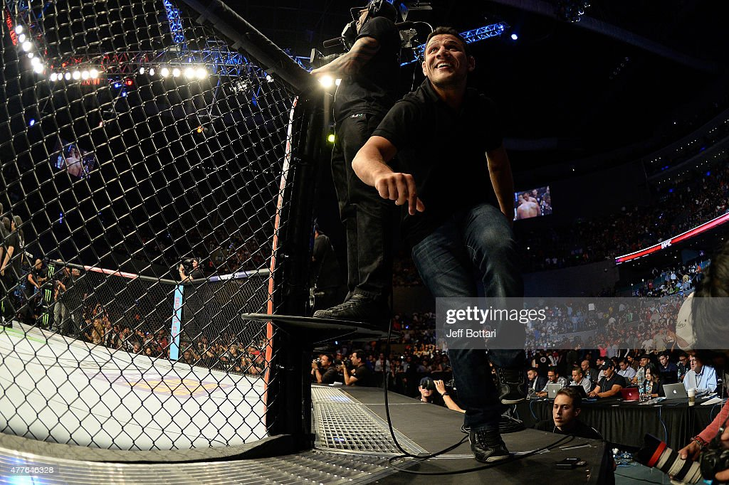 UFC lightweight champion Rafael dos Anjos runs to congratulate Fabricio Werdum of Brazil celebrates after defeating Cain Velasquez of the United States in their UFC heavyweight championship bout during the UFC 188 event inside the Arena Ciudad de Mexico on June 13, 2015 in Mexico City, Mexico.