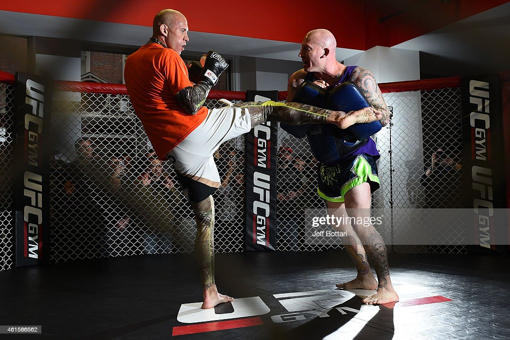 UFC lightweight Donald 'Cowboy' Cerrone (L) works out for the media and fans during the open workouts session at UFC Gym on January 15, 2015 in Boston, Massachusetts.