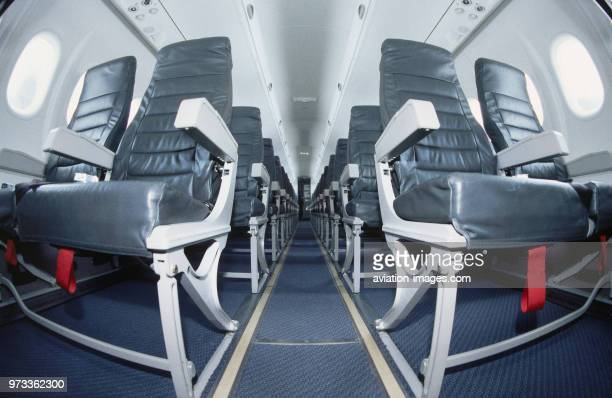 lightweight economyclass cabin leather seats and red life jacket tabs showing under seats in a SAS Bombardier DHC8 Dash 8400 Q400