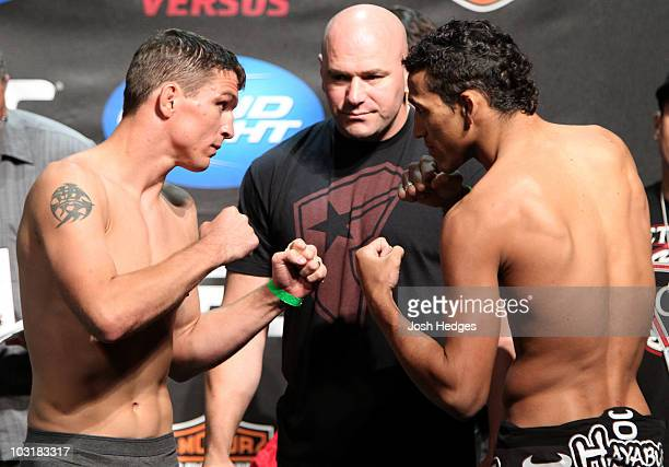 UFC Lightweight fighters Darren Elkins and Charles Oliveira square off at the UFC Live on Versus 2 official weighin on July 31 2010 at the San Diego...