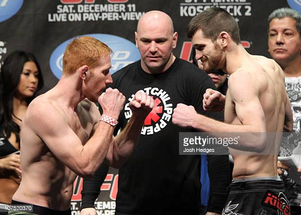 Lightweight opponents Mark Bocek and Dustin Hazelett face off as UFC President Dana White looks at the UFC 124 Weigh-in at the Bell Centre on...