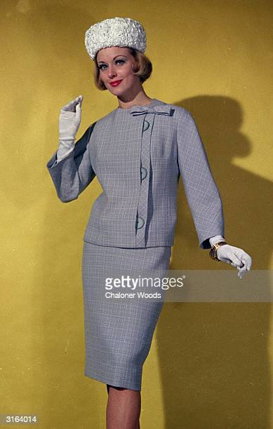 Lightweight suit Collarless jacket has asymmetrical button fastening with a bow at the neckline and bracelet length sleeves Worn with a white ruched...