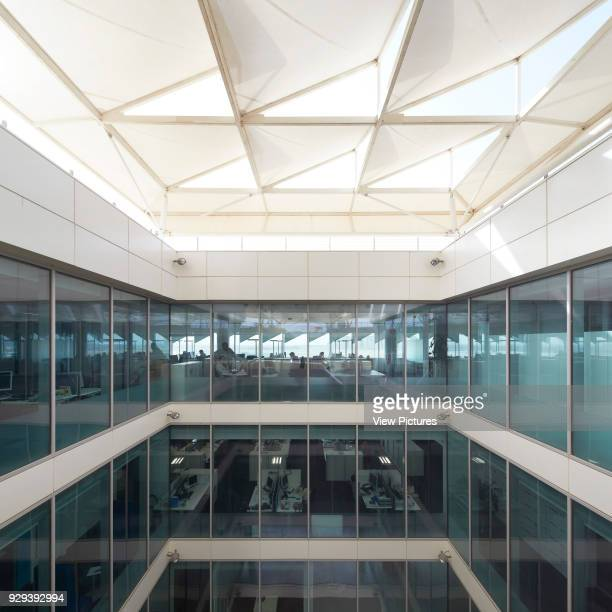 Lightwell with sun shading system. Siemens Masdar, Abu Dhabi, United Arab Emirates. Architect: Sheppard Robson, 2014.