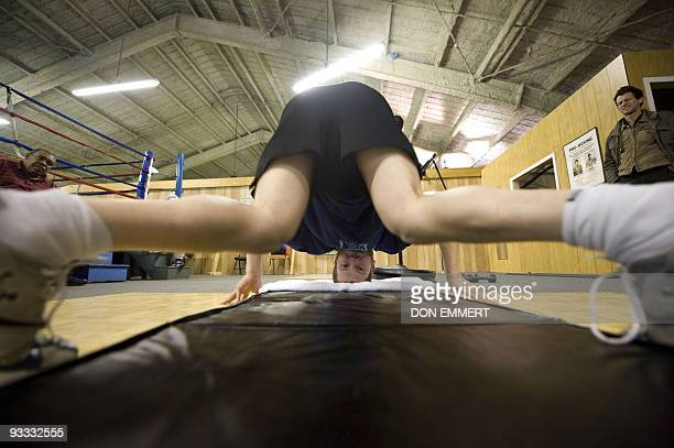 Light-welterweight number one boxing contender Dmitriy Salita stretches after his workout November 12, 2009 in Bushkill, Pennsylvania. Salita, an...